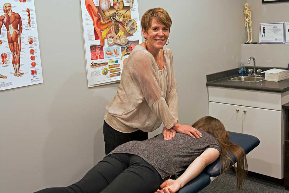 Receiving manual physiotherapy